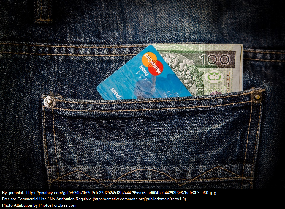 Credit card and money in jeans